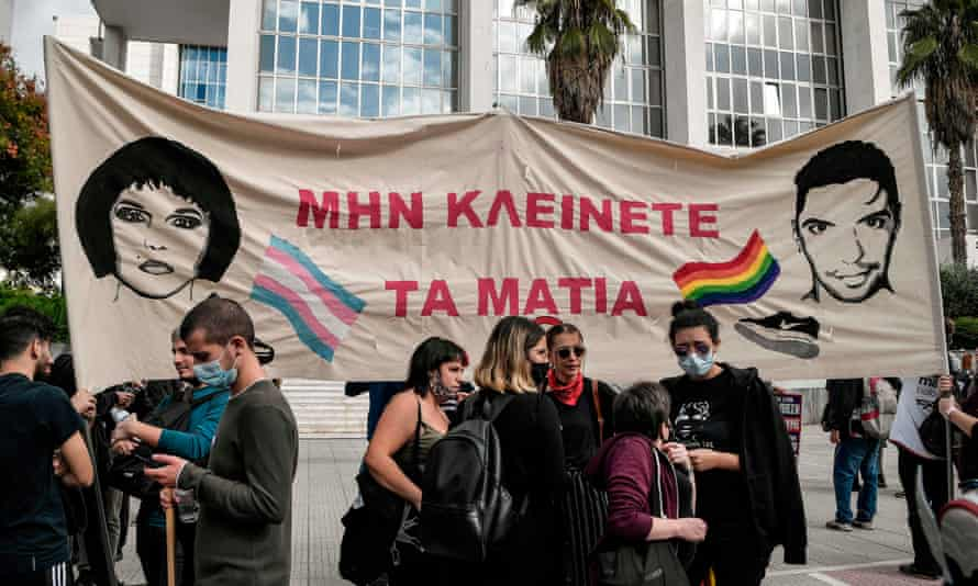 Protesters hold a banner reading 'Don't close your eyes' and bearing the image of Zak Kostopoulos and his alter ego Zackie Oh outside an Athens court.