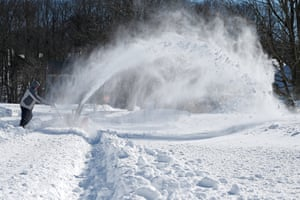 A man uses a snowblower in Forest Hill, Maryland