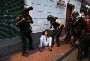 Police officers and demonstrators clash during a protest held to show solidarity with the Wikileaks founder, Julian Assange