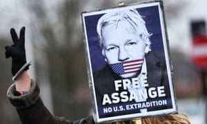 Protester with Free Assange poster