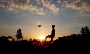 A teenage boy playing football
