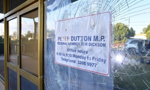 Damaged glass windows are seen at the electorate office of Peter Dutton in the suburb of Strathpine, north of Brisbane.