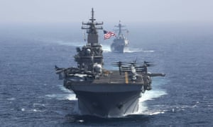 The USS Kearsarge and USS Bainbridge sail as part of the USS Abraham Lincoln aircraft carrier strike group, which was sent to the Gulf.