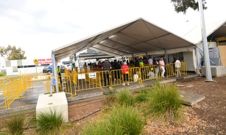 People queue at the Goulburn Valley Health-Mcintosh Covid testing facility in Shepparton