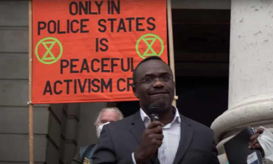 Chidi Oti-Obihara speaking at a protest in the City of London last week.