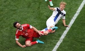 Russia's Georgi Dzhikiya reacts after a challenge from Finland's Joel Pohjanpalo.