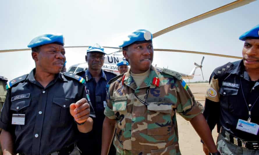 General Karenzi, centre, pictured in Sudan in 2008. Karake is one of 40 current or former Rwandan military officials named on an indictment made by a Spanish judge in the same year.