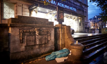 A homeless person sleeping outside a luxury hotel in Liverpool.