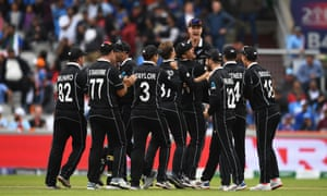 The New Zealand side celebrate as MS Dhoni of India is run out by Martin Guptill.