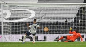 Tottenham Hotspur's Erik Lamela slots the ball home during the penalty shootout .