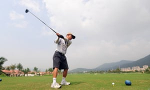 A golfer plays a round in Sanya in the island province of Hainan in China.
