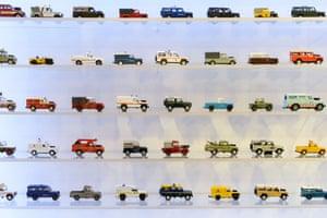 Varying incarnations of toy Land Rover Defenders on display at Bonhams auctioneers in London