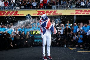 MexicoLewis Hamilton, is sprayed with Champagne by his Mercedes team after securing his fifth world drivers' title during the Mexican GP at Autódromo Hermanos Rodríguez