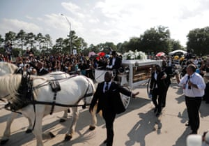 The horse-drawn carriage carrying the body of George Floyd.
