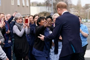 Prince Harry, Duke of Sussex is greeted by staff and well wishers as he leaves The Institute of Translational Medicine at Queen Elizabeth Hospital