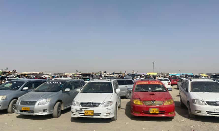 Cars wait for the refugees.