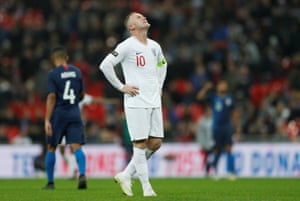 Wayne Rooney reacts after a missed chance.