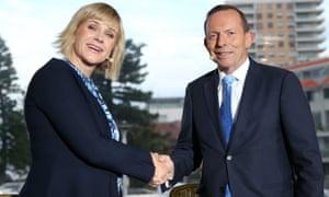 Zali Steggall and Tony Abbott shake hands