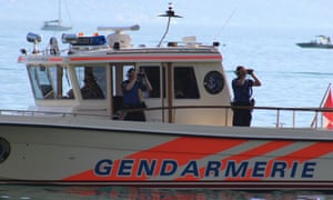 Officers aboard a Swiss police launch.