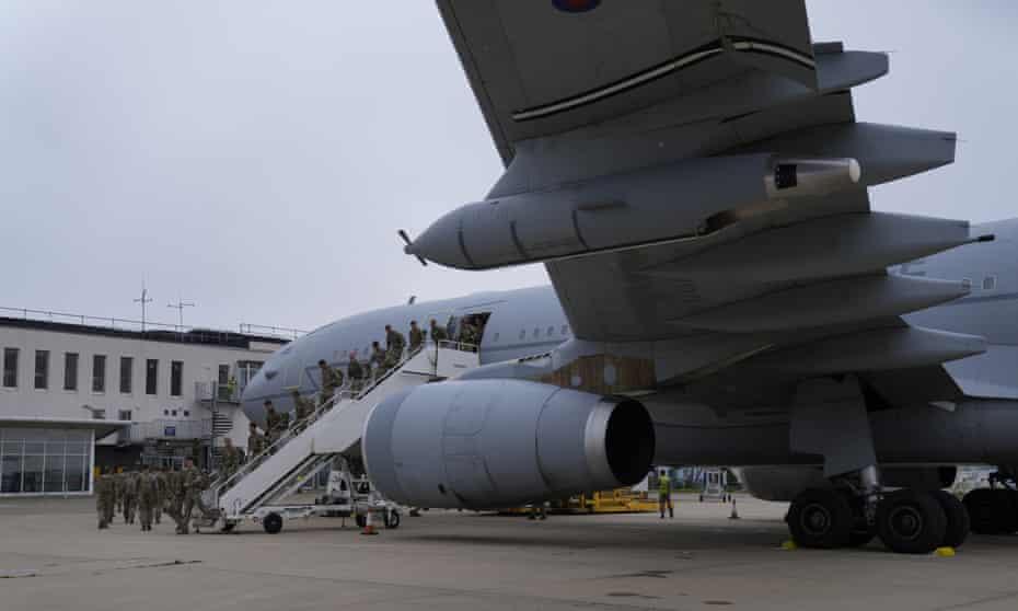 British soldiers disembark at RAF Brize Norton on Saturday.