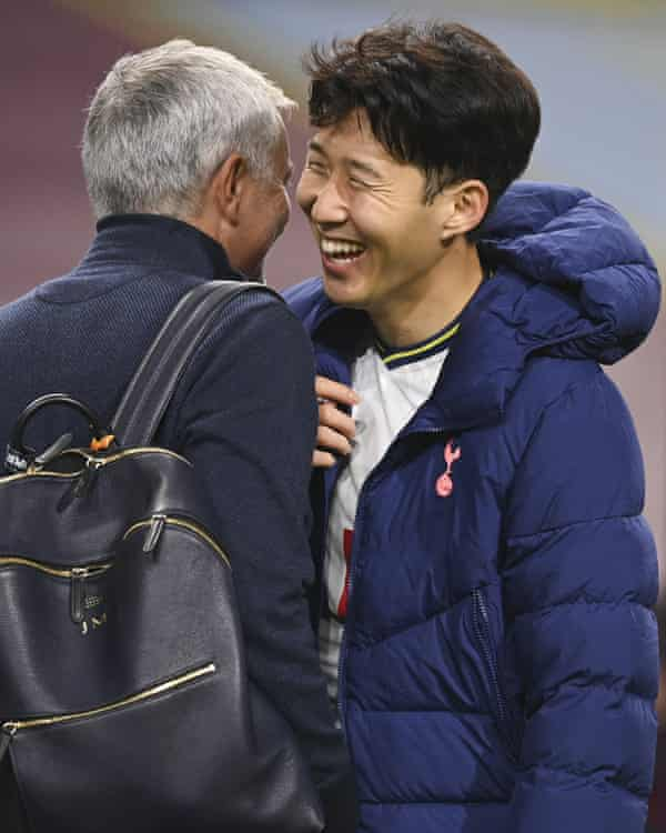 Tottenham's Son Heung-min (right) jokes with José Mourinho following the final whistle in Burnley.