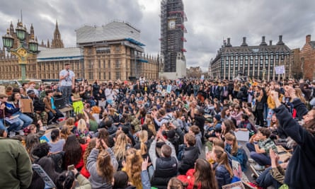 Young supporters of Extinction Rebellion block Westminster Bridge in London, 15 March 2019