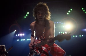 """Dutch-American musician, songwriter and lead guitarist of the hard rock band Van Halen, Eddie Van Halen, performs during the band's """"Fair Warning Tour"""" on July 3, 1981, at Cobo Arena in Detroit, Michigan."""