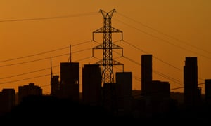 A high voltage electricity transmission tower is seen in the foreground of the Brisbane CBD skyline