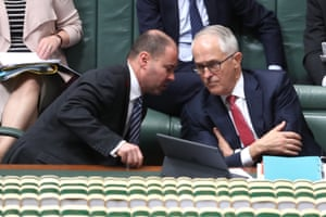 The Prime minister Malcolm Turnbull talks to minister for Energy and the environment Josh Frydenberg during question time