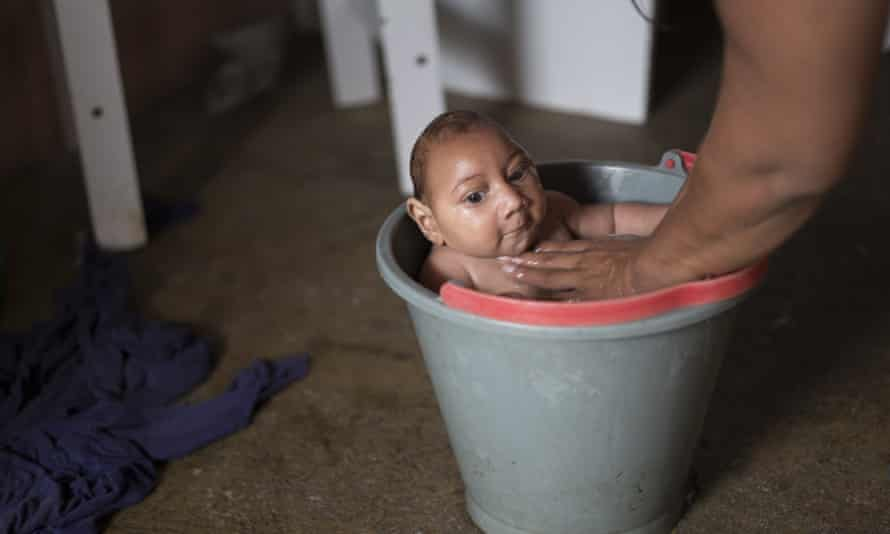 Solange Ferreira bathes her son Jose Wesley, who was born with microcephaly, at their home in Poco Fundo, Brazil on 23 December 2015.