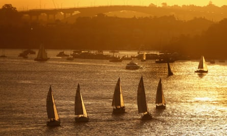 SYDNEY, AUSTRALIA - APRIL 01: Yachts sail in a twilight regatta on Sydney Harbour on April 1, 2015 in Sydney, Australia. (Photo by Cameron Spencer/Getty Images)