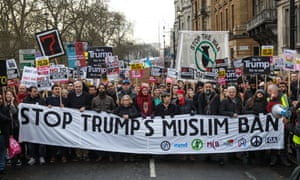 Thousands of protesters with banners and placards march through central London.
