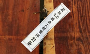 "A seal on the entrance to a closed building site in Hangzhou reads: ""Project suspended in order to welcome the G20 Summit""."