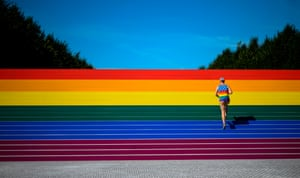 New York City, US. A man walks up rainbow-coloured steps decorated for Pride month at Franklin D Roosevelt Four Freedoms Park