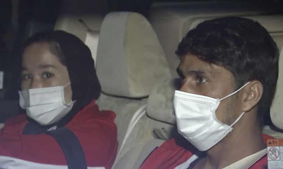 The Afghan athletes Zakia Khudadadi and Hossain Rasouli arrive at Haneda airport in Tokyo.