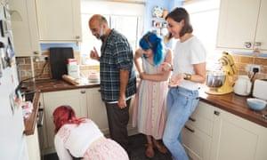 Kitchen party: Kim-Joy (kneeling) with (from left) Tair, Rowan and Lauren.
