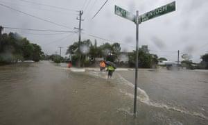 Residents walk through floodwaters in Hermit Park, Townsville