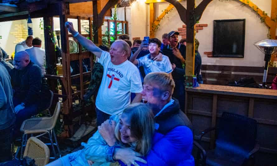 England supporters at the Spread Eagle pub in Stokesley, North Yorkshire, watch the team in the Euro 2020 semi-finals.