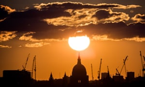 Sunset on a summer evening over St Paul's cathedral in London. The UK's average temperature is currently cooler than 13C, meaning the economy may improve a little as temperatures rise.