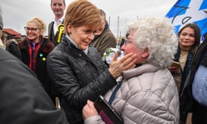 Nicola Sturgeon and Dave Doogan, SNP candidate for Angus, meets with activists and supporters on the British General election campaign trail on November 16, 2019 in Arbroath, Scotland.