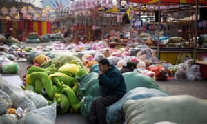 Migrant workers take lunch break on the bags of soft toys dismantled from the stores in China.
