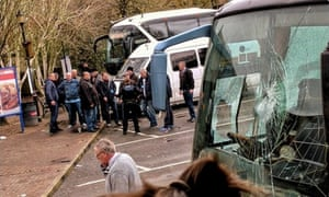 Protesters photographed after clash that resulted in damage to coaches at service station near Dover.