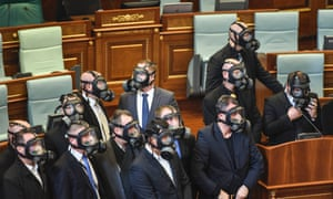 Kosovo police wearing gas masks stand guard after the Parliament opposition lawmakers released tear gas in the Kosovo's parliament in Pristina, on December 14, 2015.