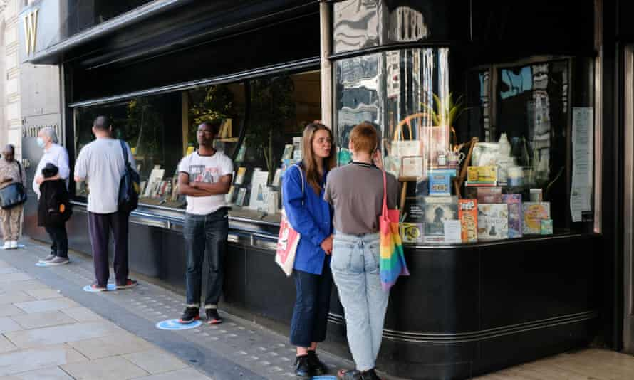 Customers queue outside a branch of Waterstones.
