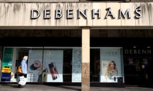 A person walks past a Debenhams store in Nottingham.