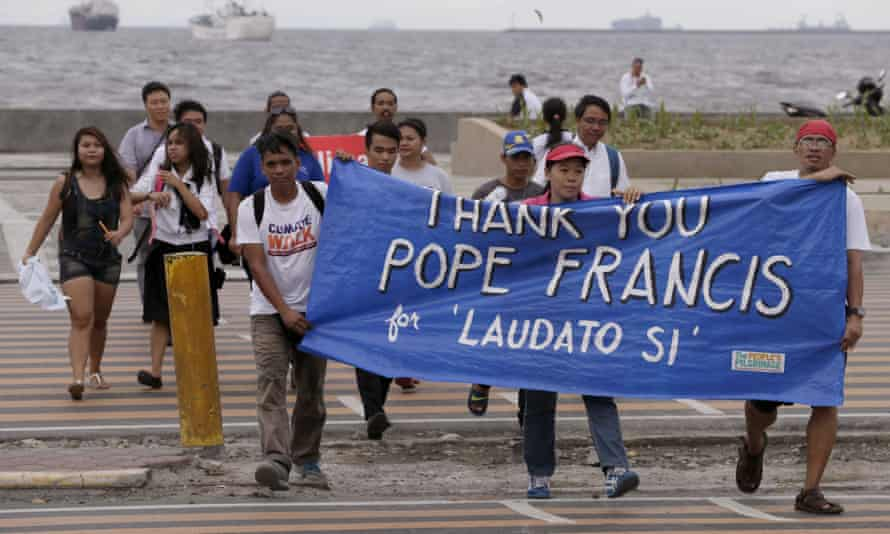 Filipino environmental activists on a Manila march thank Pope Francis for his encyclical, Laudato Si.