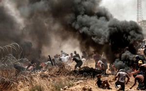 Palestinians cower under live fire as they clash with Israeli forces