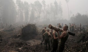Russian servicemen remove felled trees outside the town of Lukhovitsy in 2010.