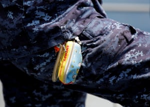 A female navigator wears a Snoopy keyholder during routine drills