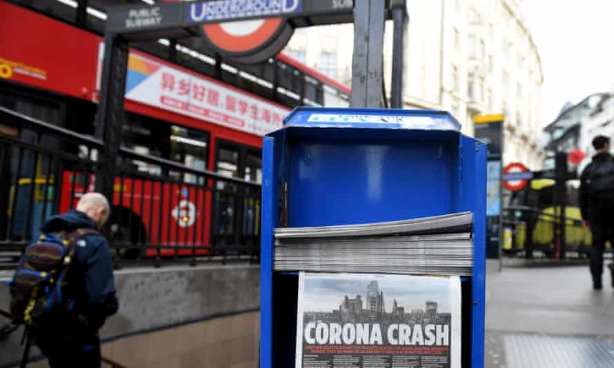 Newspapers on a stand in the City of London on 13 March